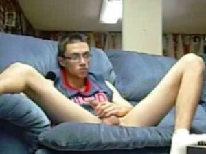 Slim American Nerd Solo On The Couch